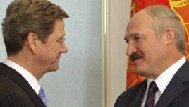 Belarusian President Alyaksandr Lukashenka (right) welcomes German Foreign Minister Guido Westerwelle to Minsk.