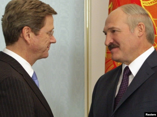Belarusian President Alyaksandr Lukashenka (right) welcomes German Foreign Minister Guido Westerwelle to Minsk last month, one of his new EU 'best friends.'