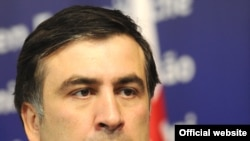 "Saakashvili warned of the ""grave risks of returning to business as usual"" without holding Russia to account."