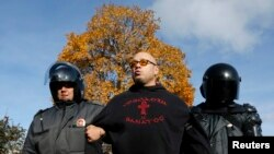Police detain an antigay protester who took part in a gathering to prevent gay rights activists from staging a protest in St. Petersburg on October 12.