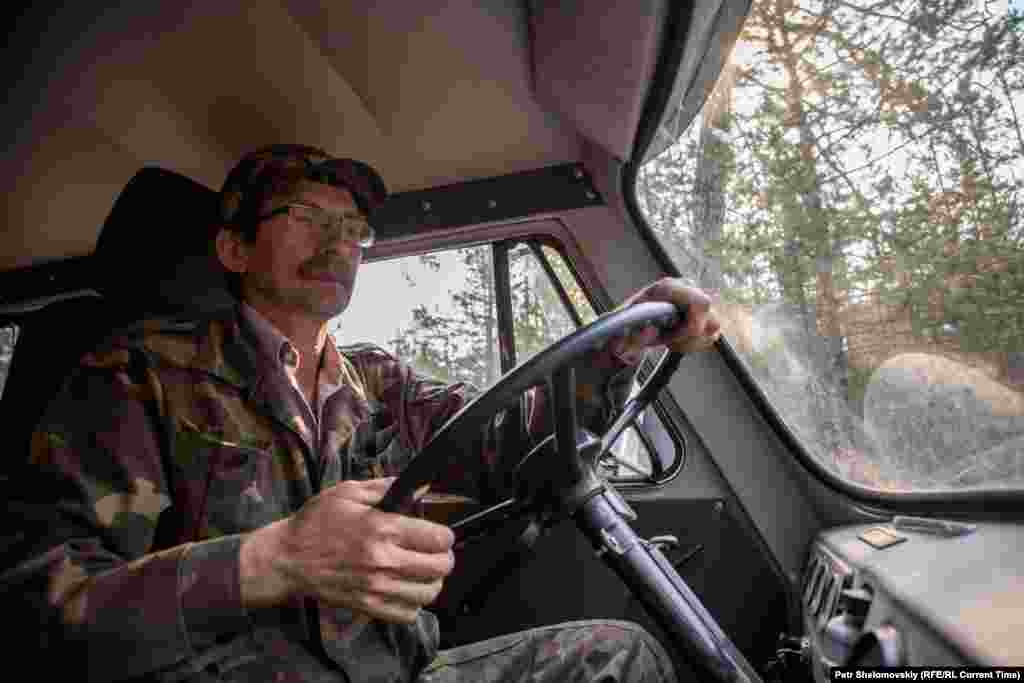 Forest service head Konstantin Kozlov drives to another emergency site to check on the damage.