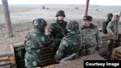 Azerbaijan -- Defense Minister Zakir Hasanov meets soldiers, 25 November 2014.