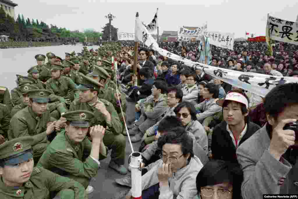 CHINA -- Several hundred of 200,000 pro-democracy student protesters face to face with policemen outside the Great Hall of the People in Tiananmen Square in Beijing, April 22, 1989