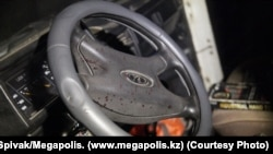The blood-splattered steering wheel of the Niva belonging to Panayot Zakharopulo