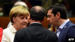 German Chancellor Angela Merkel (left), French President Francois Hollande (center), and Greek Prime Minister Alexis Tsipras confer during intense bailout negotiations in Brussels on July 12.
