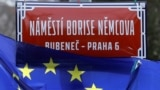 "CZECH REPUBLIC -- An EU flag flutters near an unveiled sign carrying the name of slain Russian political opposition leader Boris Nemtsov during a ceremony to rename a square near the Russian Embassy into ""Boris Nemtsov Square"", in Prague, February 27, 202"