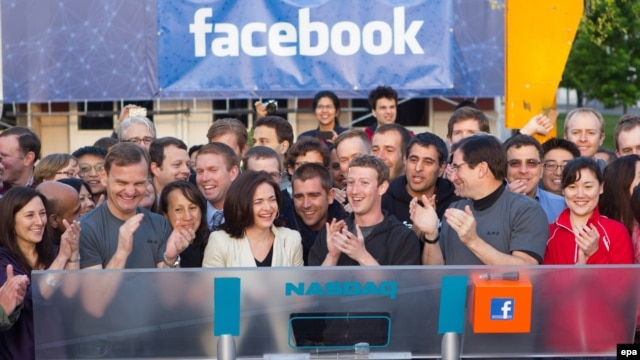 Facebook founder, chairman, and CEO Mark Zuckerberg (center) after ringing Nasdaq's opening bell from Facebook headquarters in Menlo Park, California.