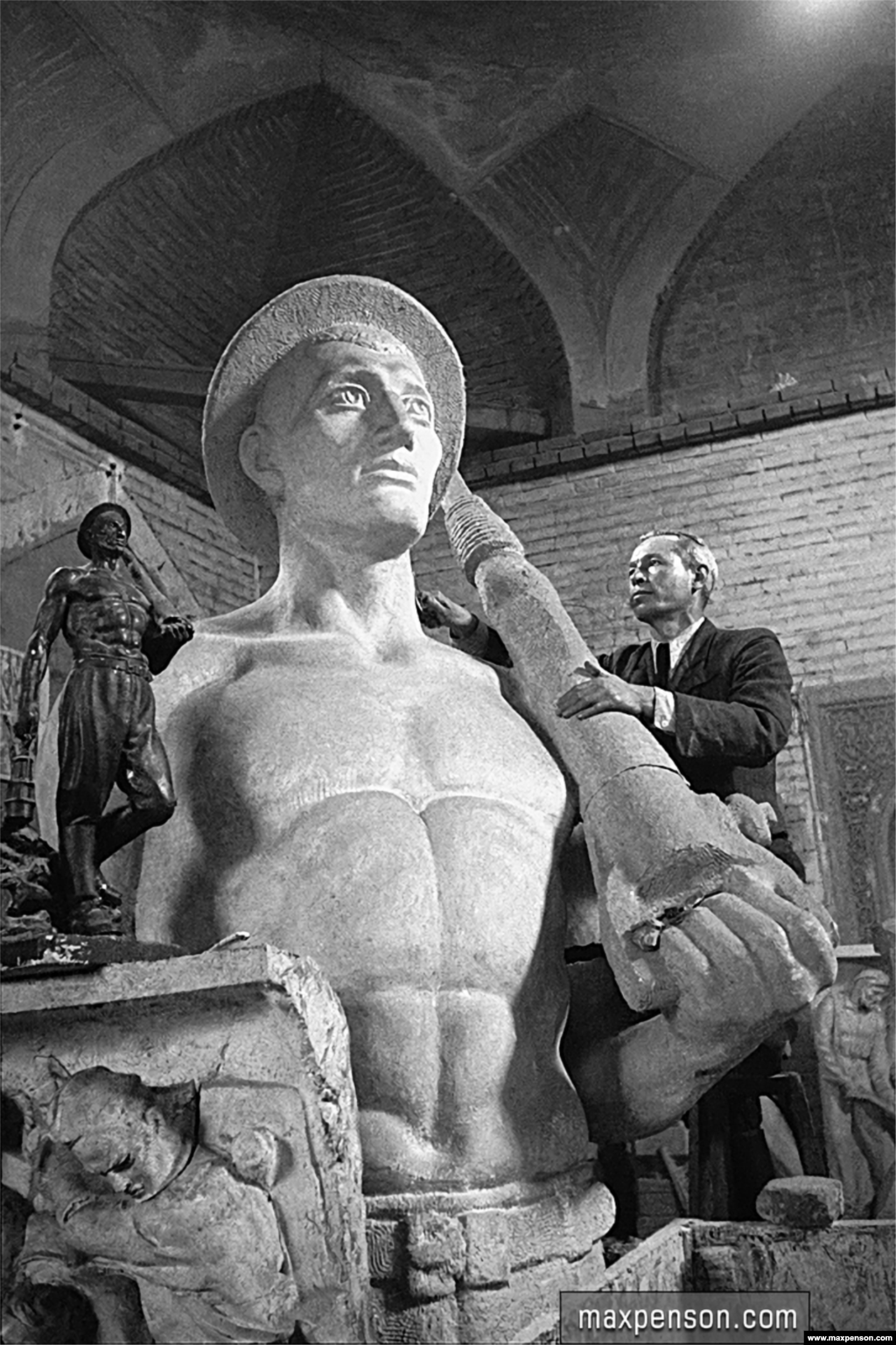 The workshop of sculptor N. Krasovsky in 1943. The chiseled figure of a miner was later installed in central Tashkent.