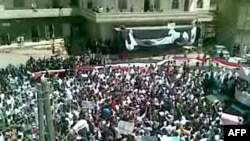 Syria -- A video grab shows hundres of anti-regime protesters demonstrating in the southern city of Daraa, 19Aug2011