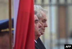 Tajik President Emomali Rahmon (left) with his Czech counterpart, Milos Zeman, during a visit to Prague on December 1.