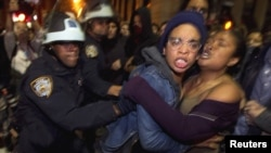 Members of the Occupy Wall Street movement clash with police officers after being removed from Zuccotti Park in New York in November.