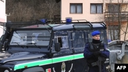 EU peacekeepers search for Mladic in the homes of close relatives in Bosnia in February.