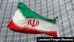 An Iranian flag in front of the International Atomic Energy Agency headquarters in Vienna.