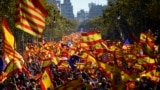 Spain -- Protesters wave Spanish and Catalan Senyera flags during a pro-unity demonstration in Barcelona on October 29, 2017