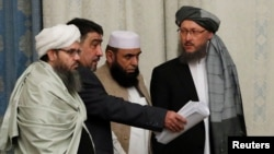 FILE: Members of the Taliban delegation take their seats during the multilateral peace talks on Afghanistan in Moscow.