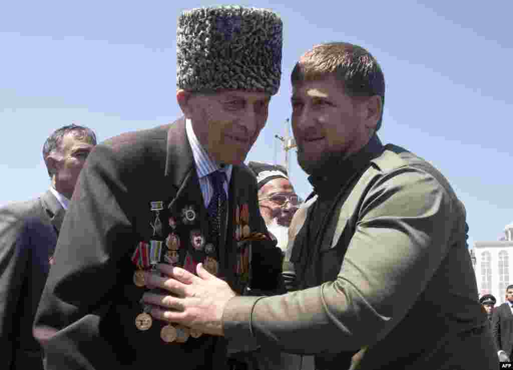 Chechen leader Ramzan Kadyrov (right) congratulates a World War II veteran in central Grozny.