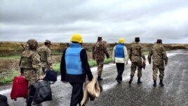 Nagorno-Karabakh - Armenian officers escort the U.S., Russian and French co-chairs of the OSCE Minsk Group on the Line of Contact northeast of Karabakh, 27Oct2015. (A screenshot of a Twitter post by James Warlick.)