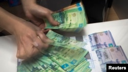 The tenge has been on the slide since August 20, when Kazakhstan's government and central bank moved to a free float, abandoning a trading corridor.