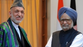 Afghan President Hamid Karzai (left) in New Delhi with Indian Prime Minister Manmohan Singh