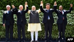 Brazilian President Michel Temer (left to right), Russian President Vladimir Putin, Indian Prime Minister Narendra Modi, Chinese President Xi Jinping, and South African President Jacob Zuma pose for a group photo during the BRICS summit in October 2016.
