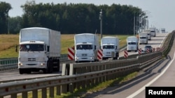A Russian convoy of trucks bound for Ukraine drives along a road near the city of Yelets, Russia, on August 12.