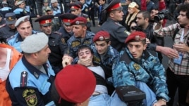 Armenia - Riot police detain a protester in Yerevan, 5Nov2013.