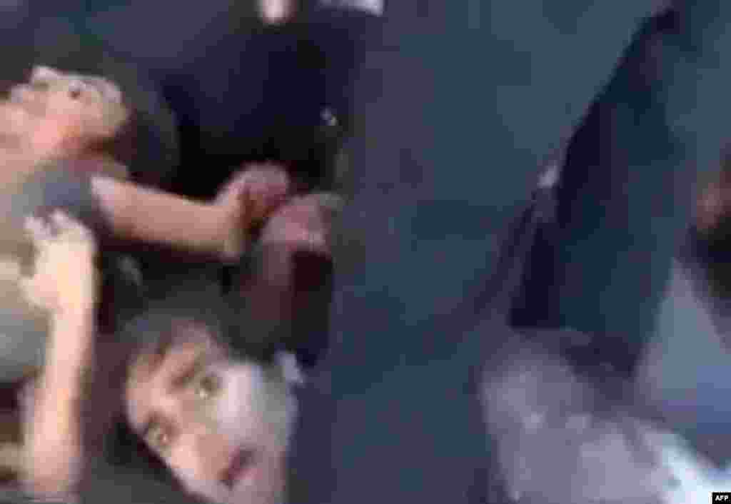 An image grab taken from a video uploaded to YouTube allegedly shows Syrian government troops lying on the ground and begging for their lives before being executed by rebel fighters near Saraqeb. A spokesman for the UN High Commissioner for Human Rights says the video appears to show a war crime. (AFP)