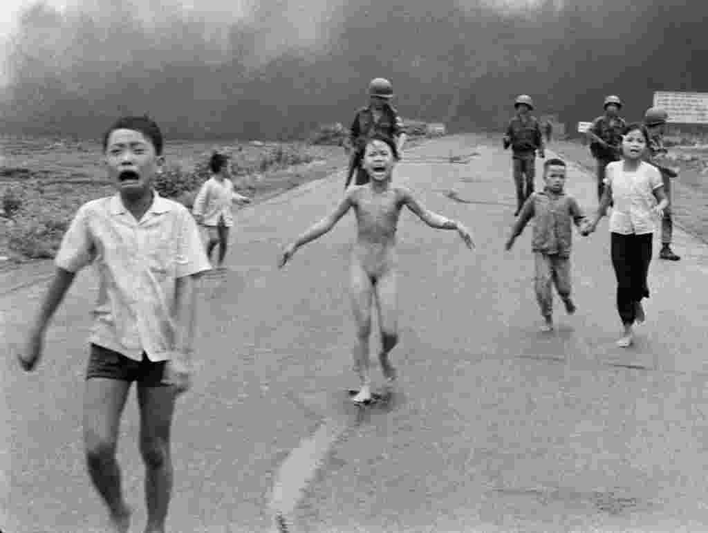 Nine-year old Phan Thi Kim Phuc (center) with other Vietnamese children after being severely burned by napalm on June 8, 1972, after a South Vietnamese plane erroneously dropped napalm on South Vietnamese troops and civilians. Kim Phuc became a symbol of civilian suffering during the war.