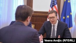 Serbian president Aleksandar Vucic (right) meets with U.S. envoy David Hale in Belgrade on March 8.