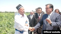 Tajik President Emomali Rahmon is warmly greeted by local officials while on a trip to the Sughd region.