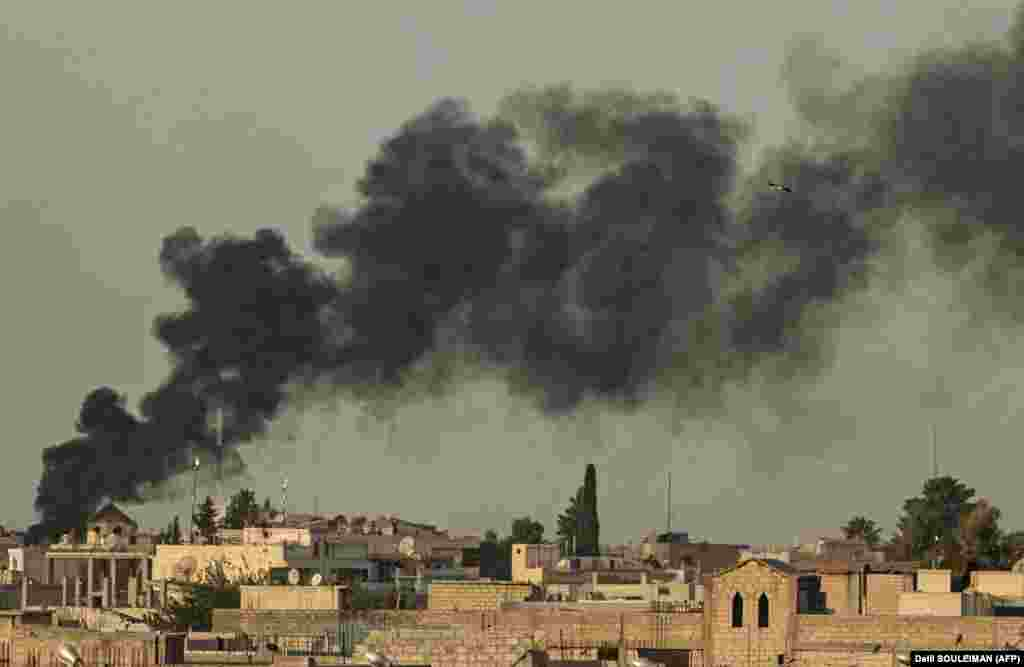 Smoke billows following Turkish bombardment on Syrian town of Ras al Ain in the Hasakeh province along the Turkish border, October 9, 2019.