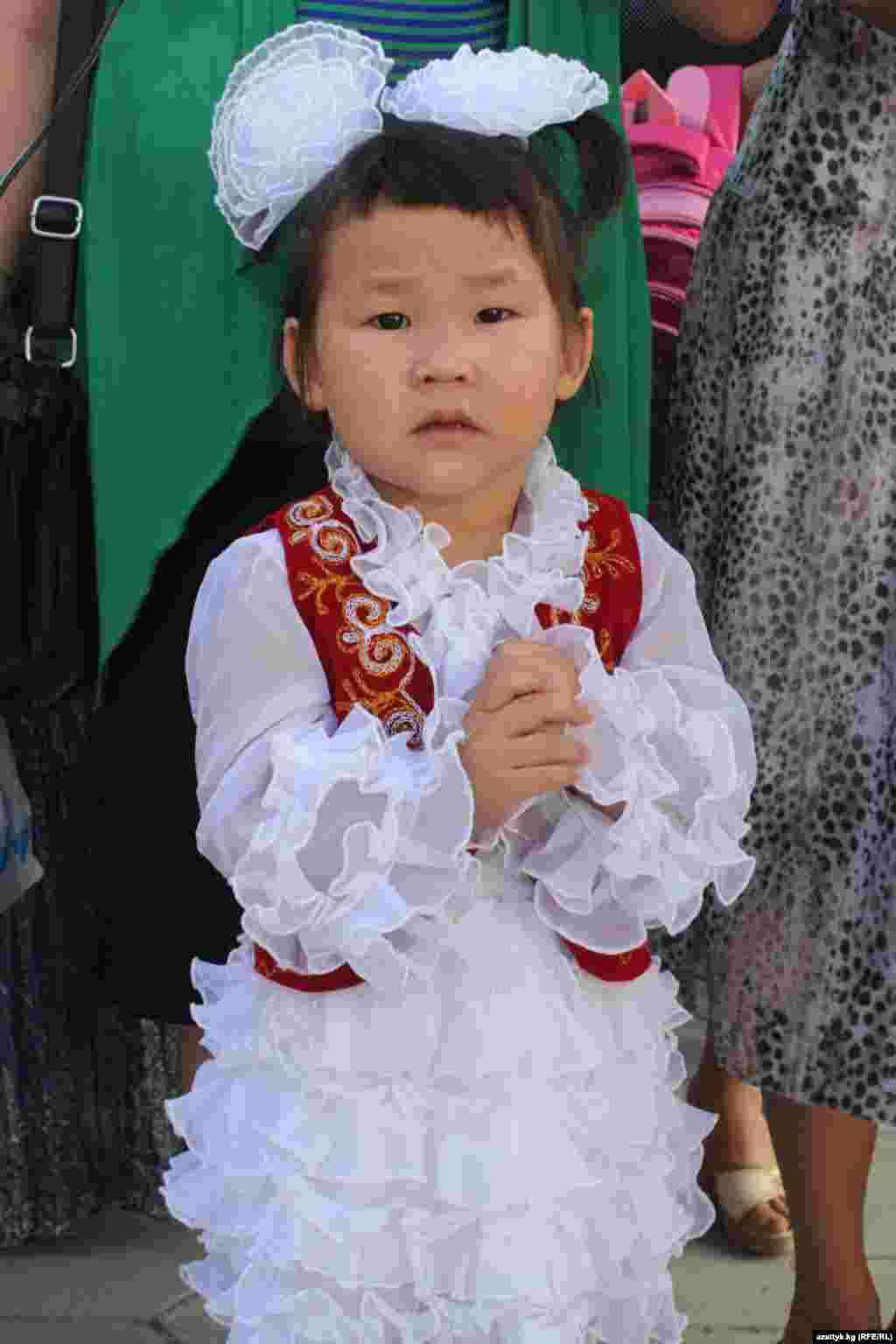 A first-grader attending a school celebration at School No. 82 at the Ala-Too settlement outside of Bishkek, Kyrgyzstan.
