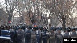 Armenia's former police chief said officers were ordered not to fire on opposition protesters.