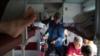 «Тут немає пісень, танців, випивань»: Про що говорять пасажири поїзда «Київ-Війна» (рос.)