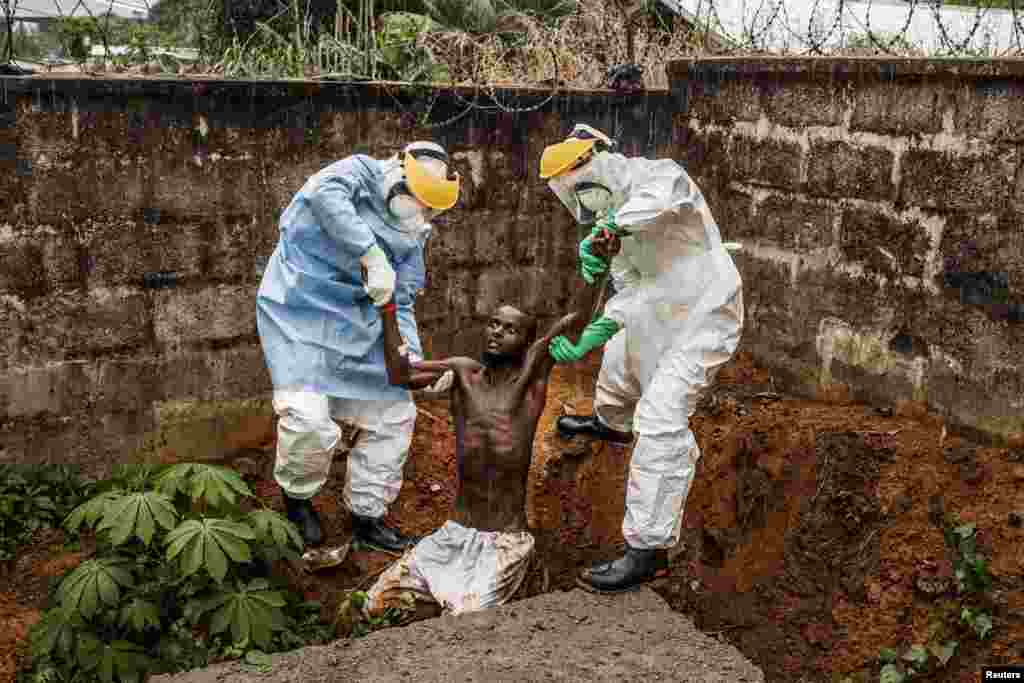 Muller, a U.S. photographer of Prime on assignment for National Geographic/The Washington Post, won First Prize in the General News Category, Stories, with his series of pictures that includes this one of medical staff at the Hastings Ebola Treatment Center escorting a man in the throes of Ebola-induced delirium back into the isolation ward from which he escaped, in Freetown.