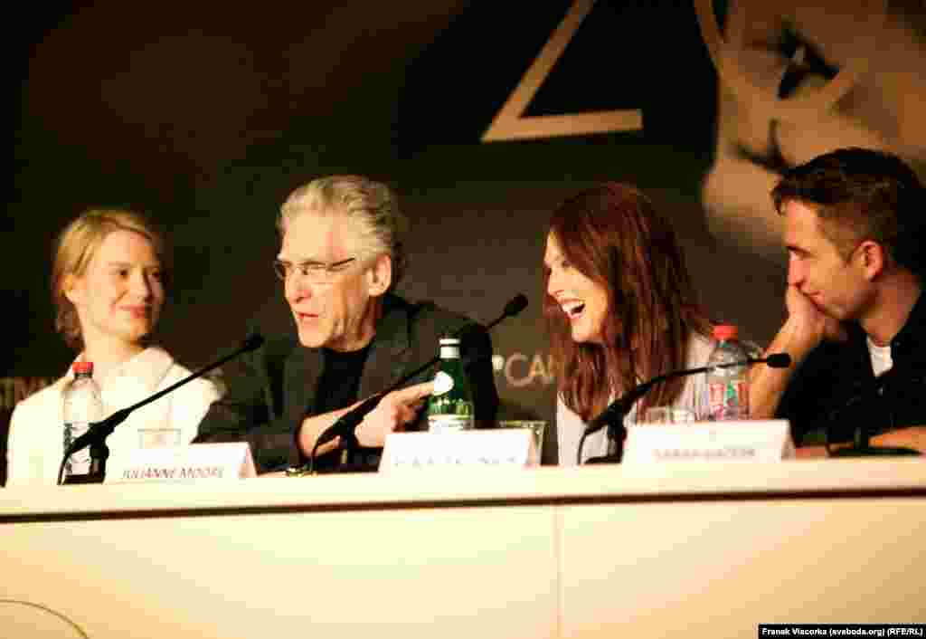 "Director David Cronenberg (second from left) speaks about his film ""Maps To The Stars"" alongside (from left) actors Mia Wasikowska, Julianne Moore, and Robert Pattinson."