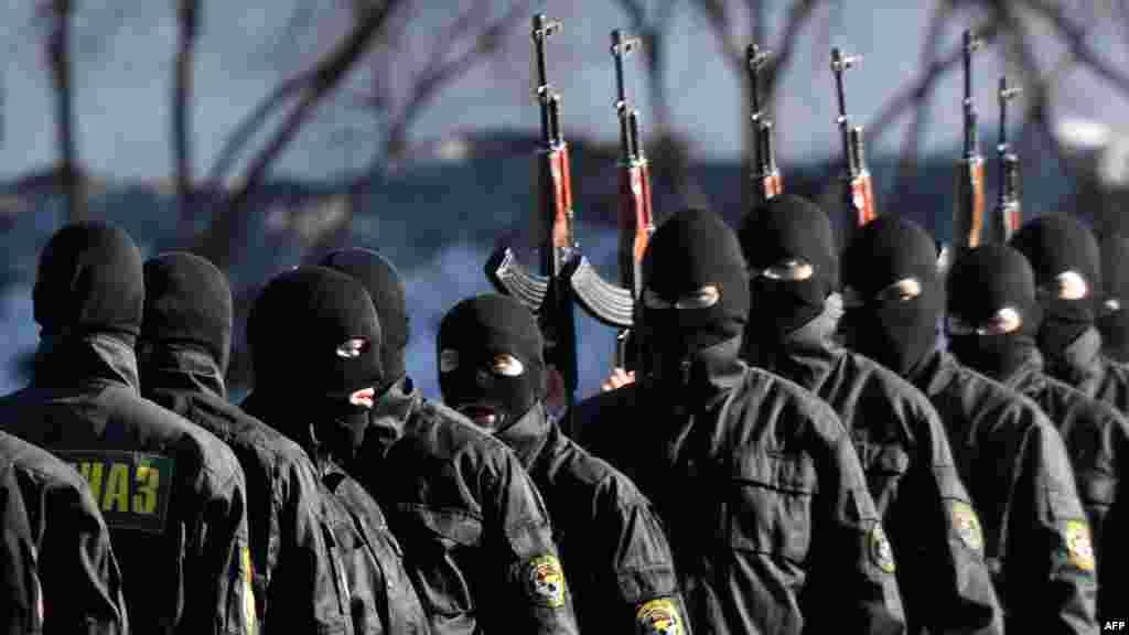Belarusian Interior Ministry troops demonstrate their skills to visiting journalists in Minsk. (AFP/Viktor Drachev)