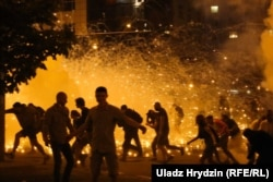 Police clash with protesters on election night in Minsk on August 9-10.