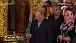 Putin, Medvedev Attend Orthodox Christmas Services