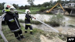 Fire fighters cleaning up in the town of Gyor