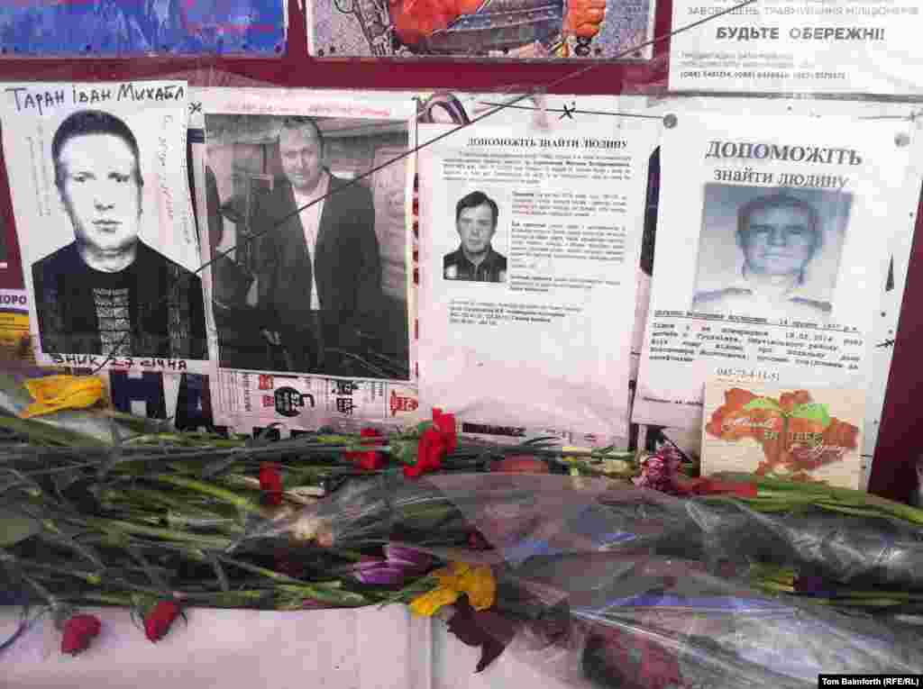 Pictures of missing people on Independence Square.