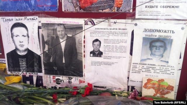 Ivan Taran's face (left) is just one of dozens that stare hauntingly out of missing-person notices on Kyiv's Independence Square.