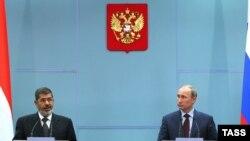 Муҳаммад Мурсӣ ва Владимир Путин