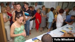 Moldovan voters at a polling station in Ialoveni on July 29
