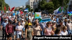 People take part in an anti-Kremlin rally in support of former regional governor Sergei Furga in the far eastern city of Khabarovsk on September 5.