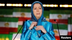 Maryam Rajavi, president-elect of the National Council of Resistance of Iran, delivers a speech during a gathering in Villepinte, near Paris, on June 30.