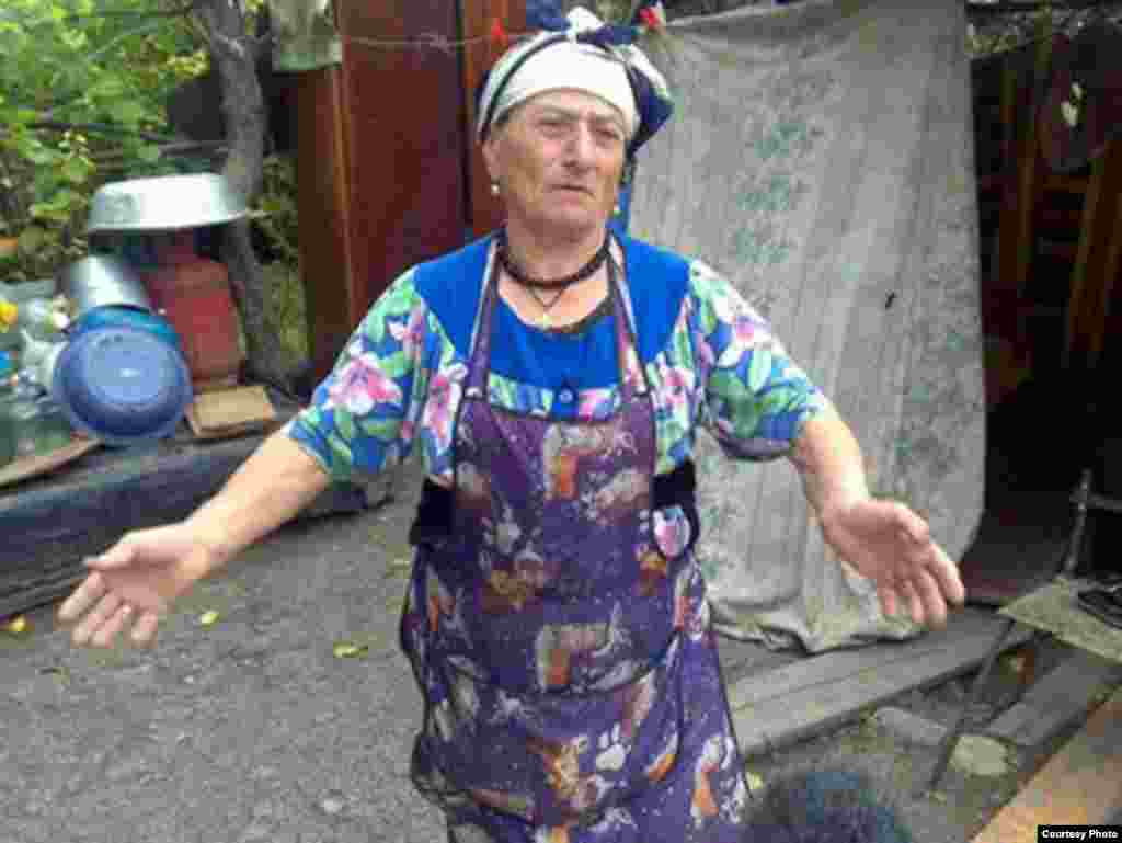 "Eteri, a poor but generous woman in Tskhinvali - ""The people are incredibly hospitable. They have come through a war but will share everything they have. I was talking to a lady, about 80. She was by coincidence Georgian, who married an Ossetian a long time ago, in a village near Tskhinvali. And a year ago, the Georgians destroyed her house and blew up her only cow, and her pigs. But they let grandma live. So this Georgian grandmother lives in a tent. I asked her why she didn't get another cow and she said she didn't have the money. She still lives in a tent, a year after the war. But that's not the point. The point is that when I was about to leave, she said: 'Wait! Wait!' And she brought out wine and some fruit...She had nothing and I'd come to bother her with my questions. And she brought out her bag with three liters of wine and two kilos of fruit."""