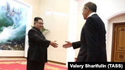 Russian Foreign Minister Sergei Lavrov (right) meets with North Korean leader Kim Jong Un in Pyongyang.