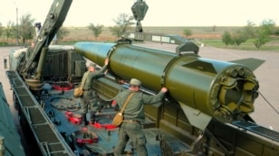 Russia -- A rocket is loaded into an Iskander-M missile launcher during a military training in the Astrakhan region, May 20, 2015