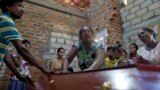 Sri Lanka Church Blasts -- Lalitha, center, weeps over the coffin with the remains of 12-year old niece, Sneha Savindi, who was a victim of Easter Sunday bombing at St. Sebastian Church, after it returned home in Negombo, Sri Lanka, Monday, April 22, 2019